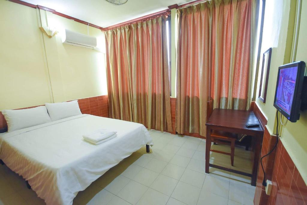 A bed or beds in a room at Intouch Guest House