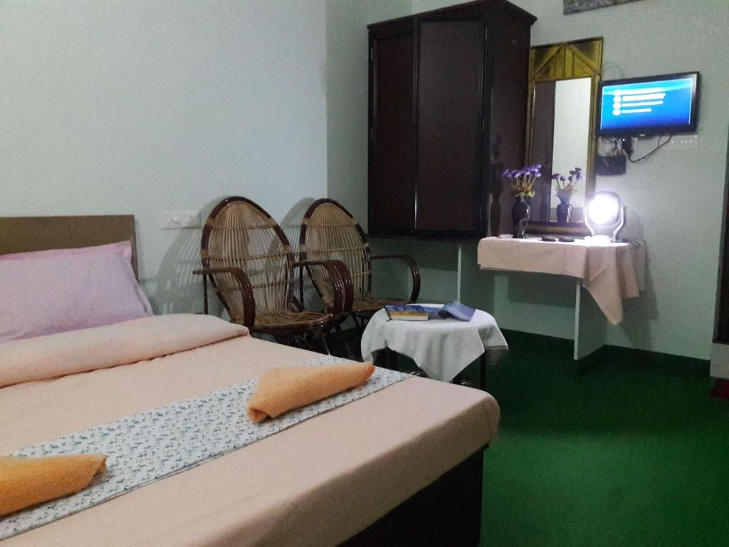A bed or beds in a room at Munnar Farmhouse