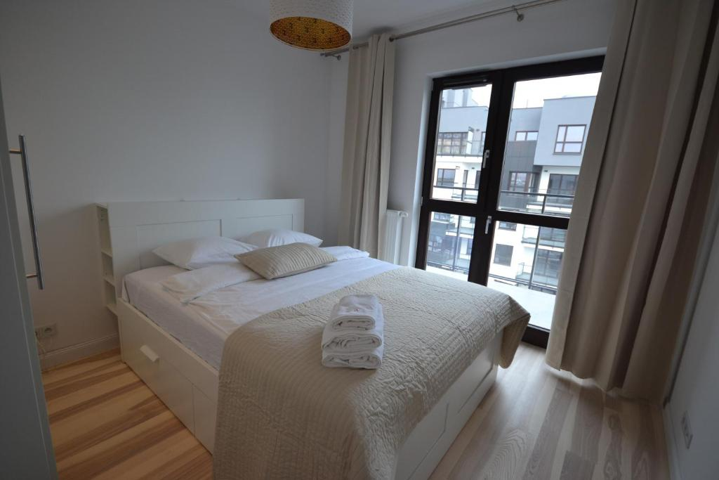 A bed or beds in a room at NotaBene Apartment
