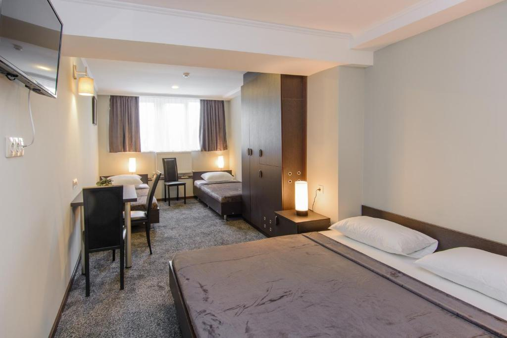 A bed or beds in a room at Hotel Reverence