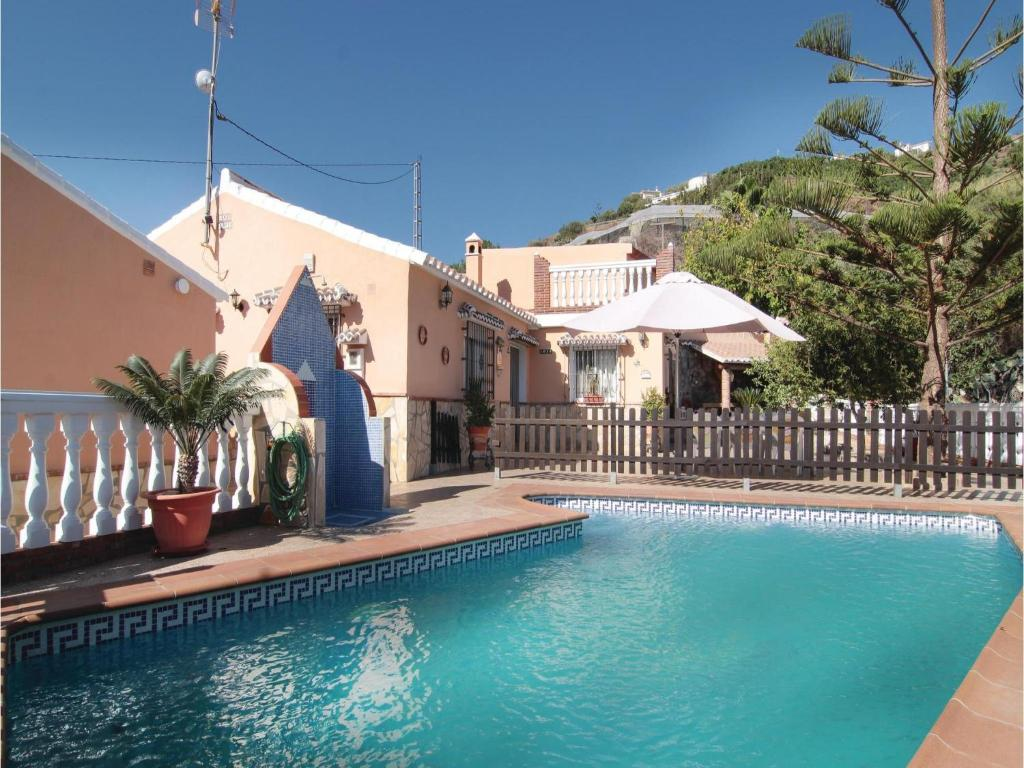 The swimming pool at or near Three-Bedroom Holiday Home in Torrox