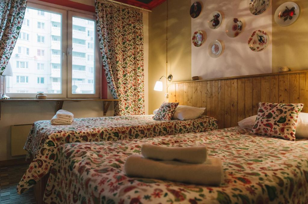 Кровать или кровати в номере Иван Чай - отель и кофейня