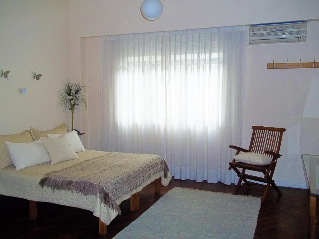 A bed or beds in a room at Departamento Posadas