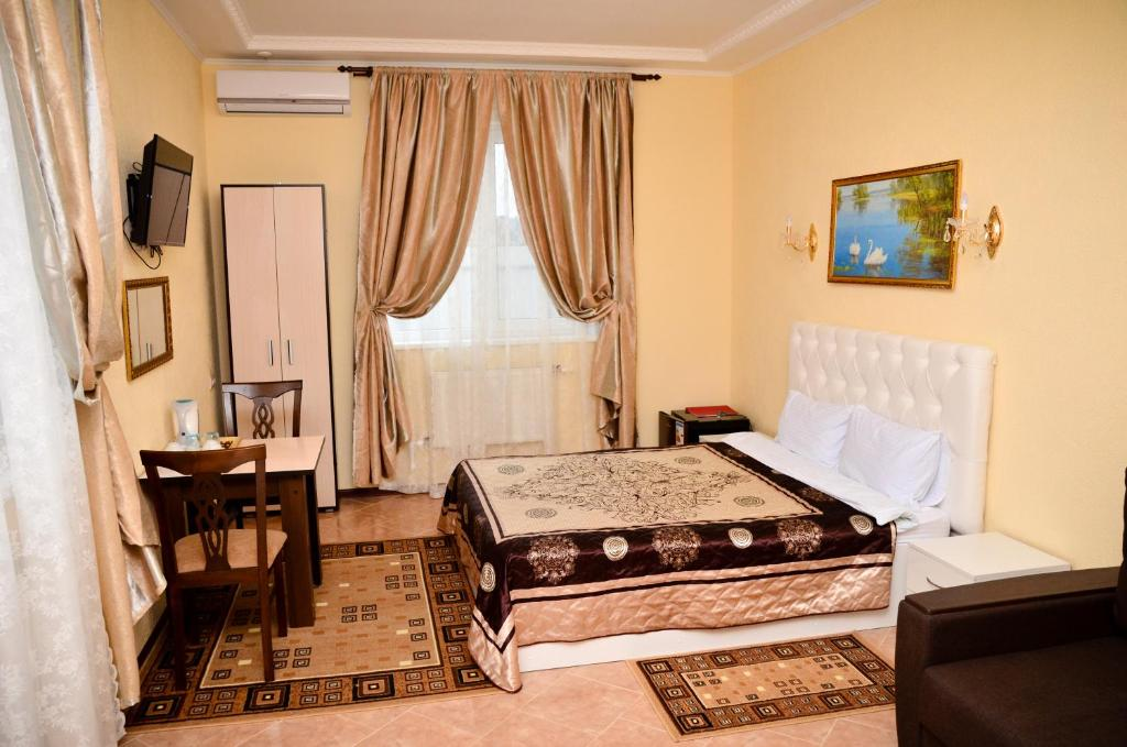 Кровать или кровати в номере Отель Александрия-Домодедово