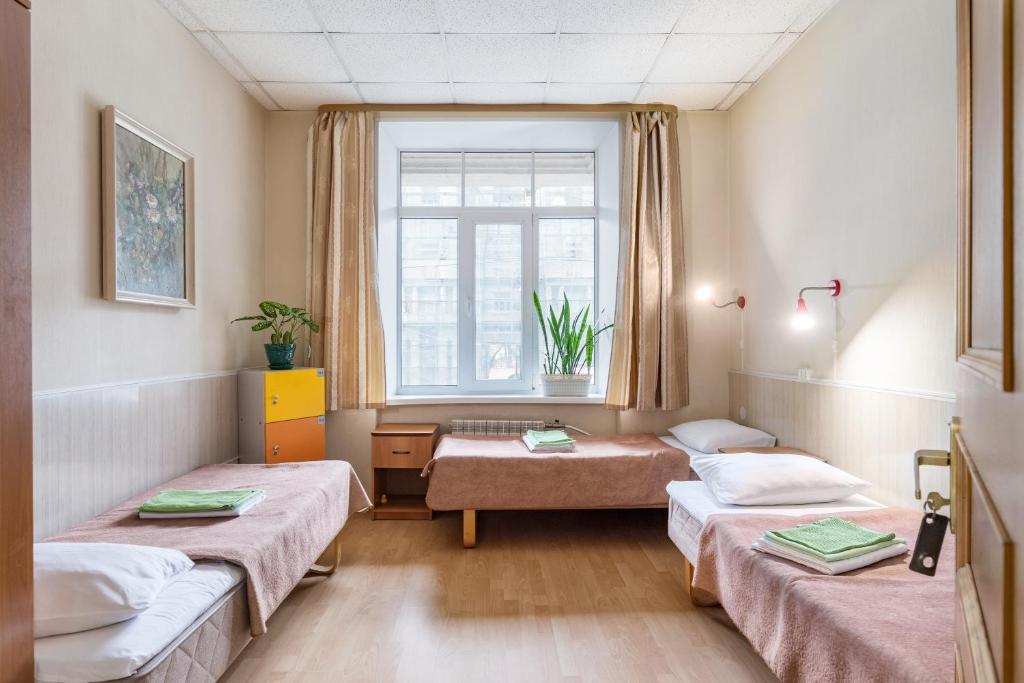 A bed or beds in a room at Metro-Tour Hostel