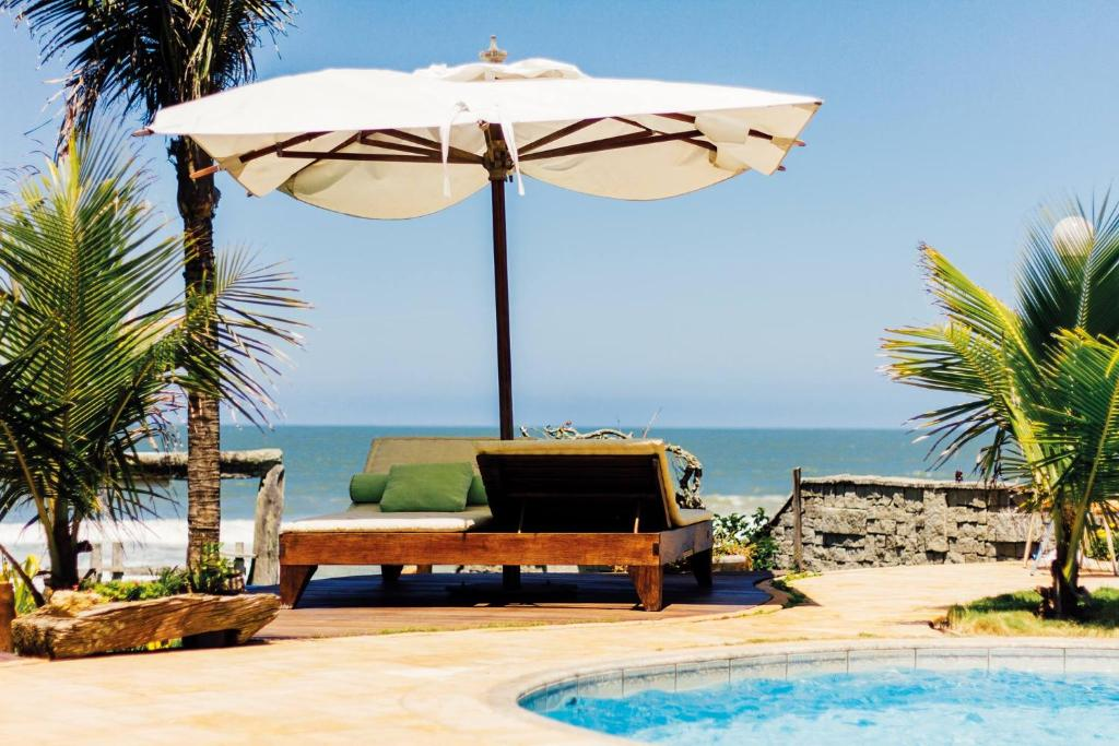 The swimming pool at or near Pousada Canto da Vigia