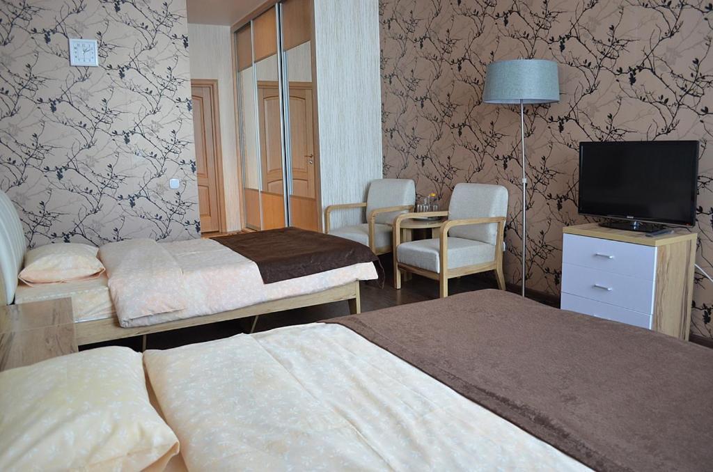 """Кровать или кровати в номере Гостиница """"Облепиха"""""""