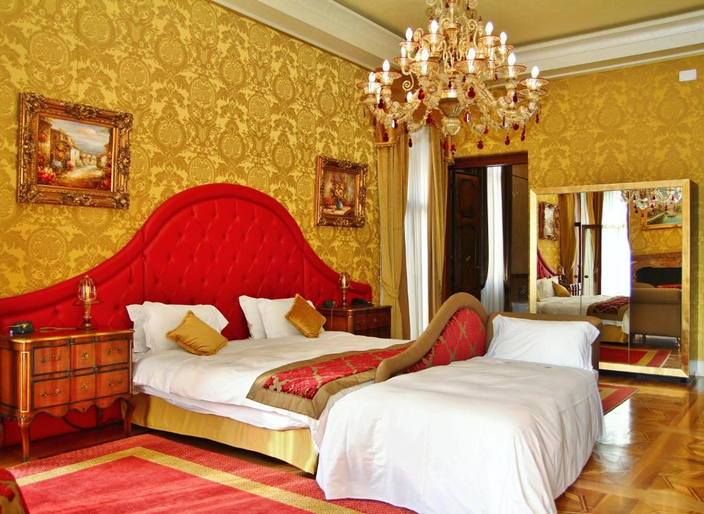A bed or beds in a room at Pesaro Palace
