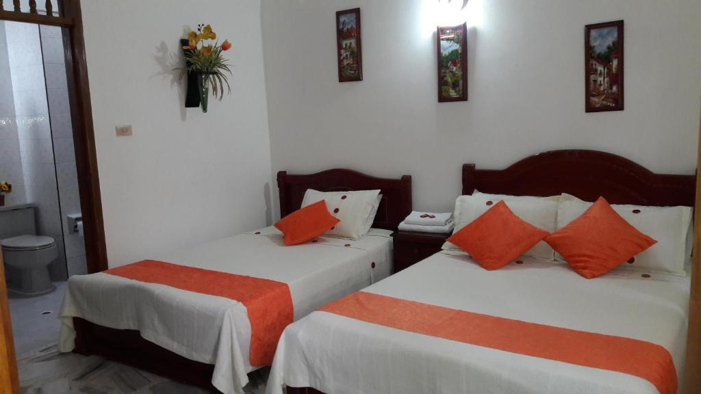 A bed or beds in a room at Hospedaje La Flor del Ingenio