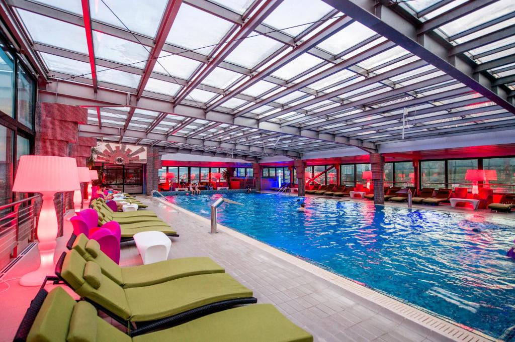 The swimming pool at or near Business Hotel Conference Center & Spa