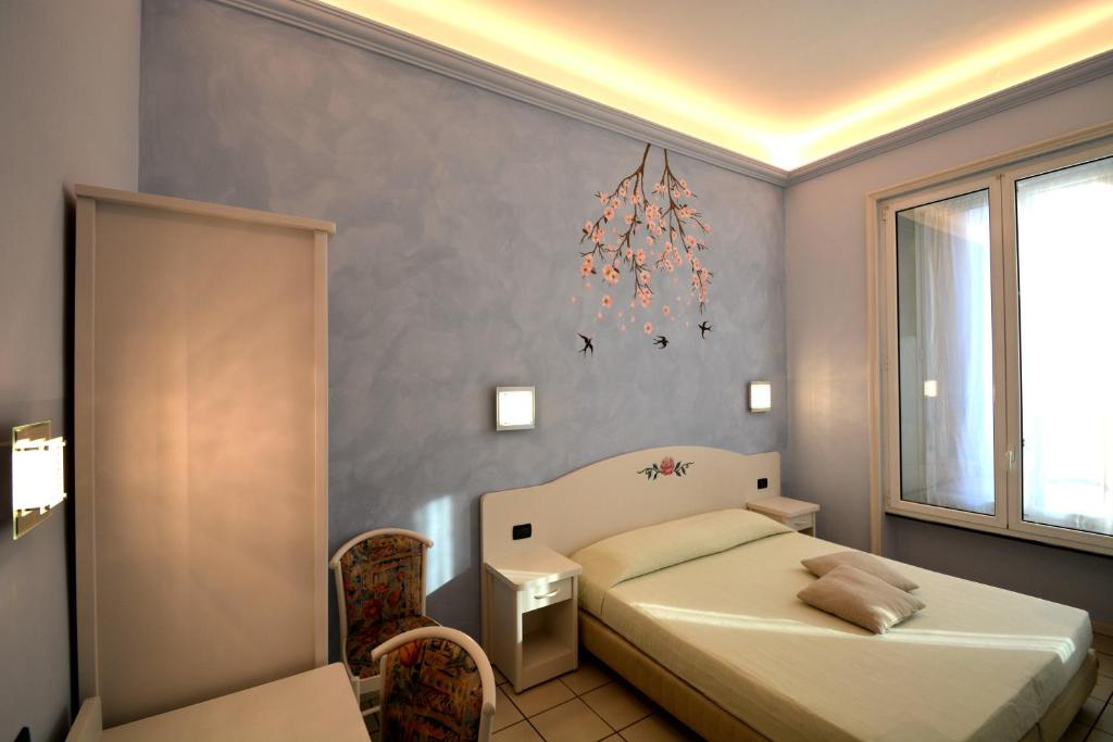 A bed or beds in a room at Soana City Rooms