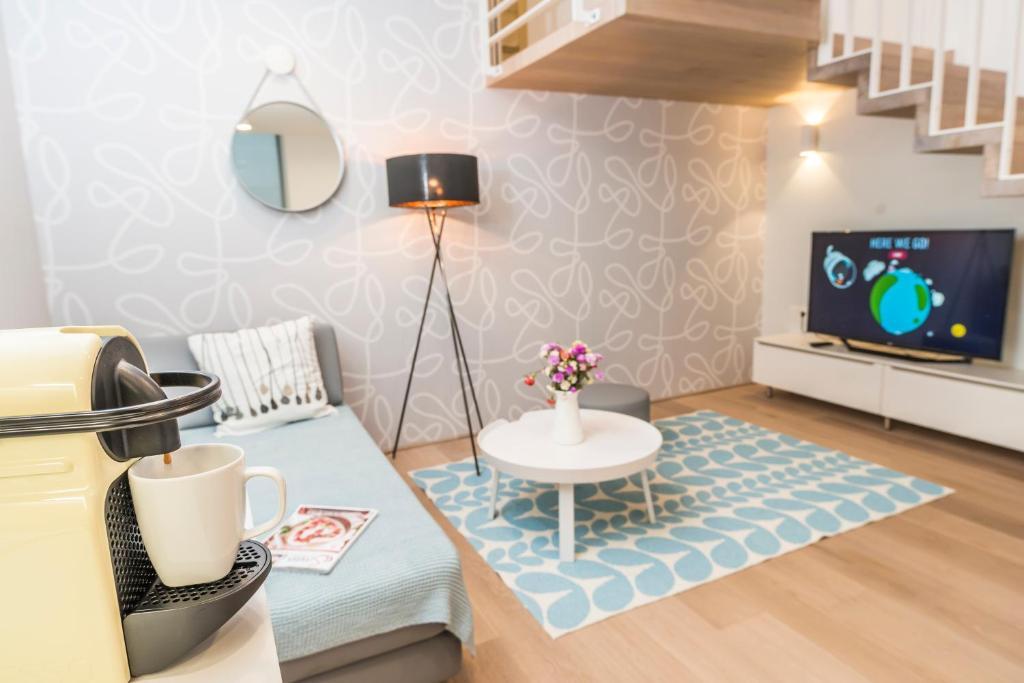 A television and/or entertainment center at Luxus Maisonette Liechtenstein by welcome2vienna