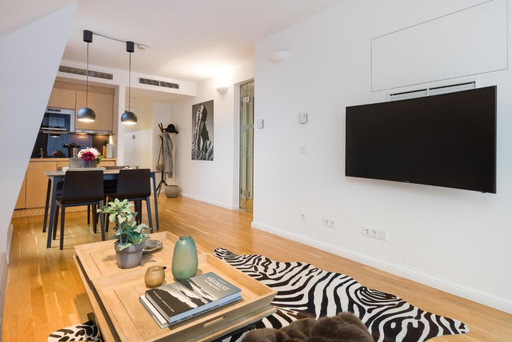 A television and/or entertainment center at Rafael Kaiser - Premium Apartments City Centre
