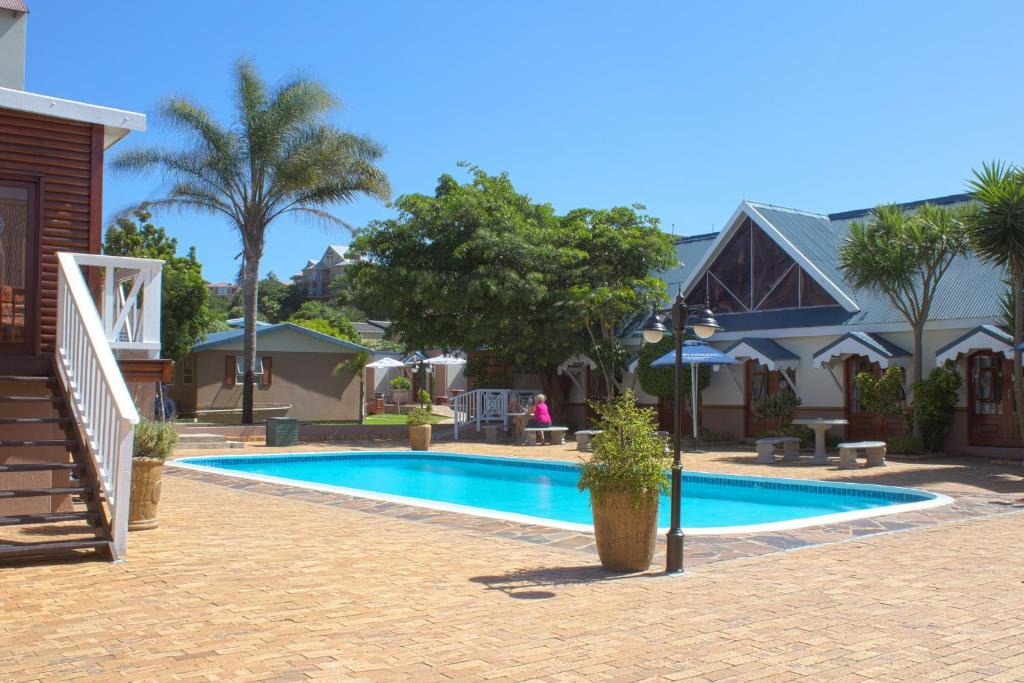 The swimming pool at or near Oceans Hotel & Self Catering