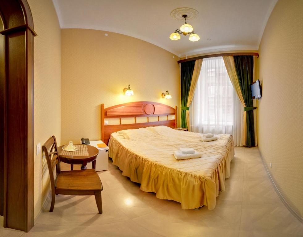 A bed or beds in a room at Hotel Adeliya