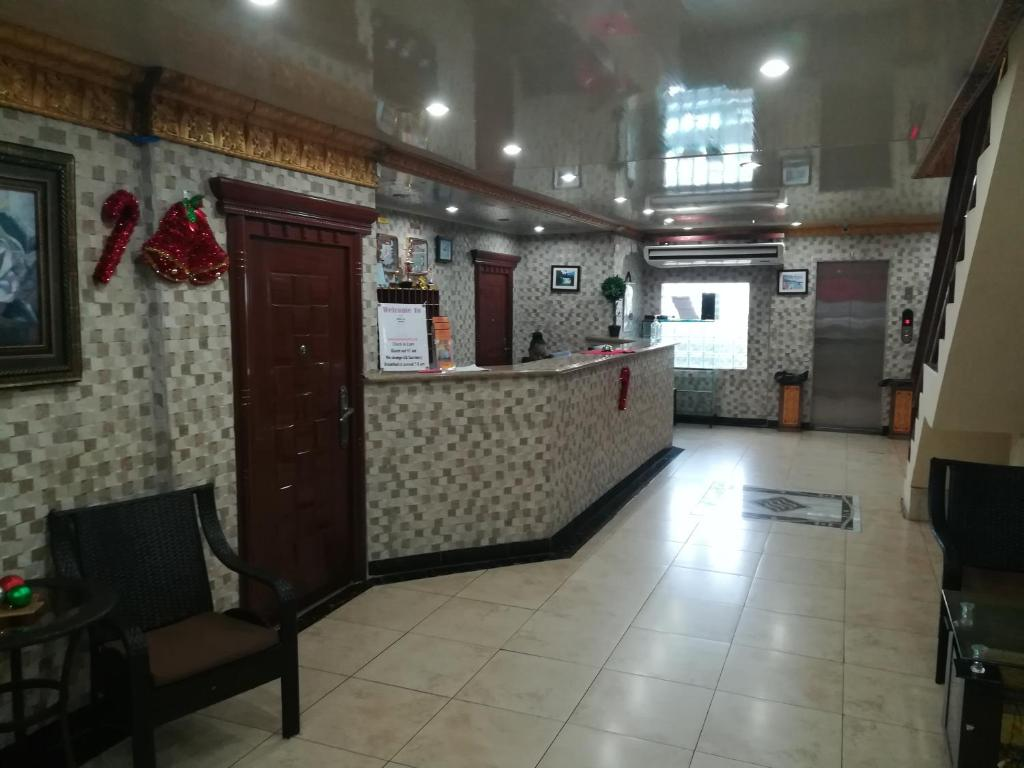 The lobby or reception area at Metro Hotel Couva