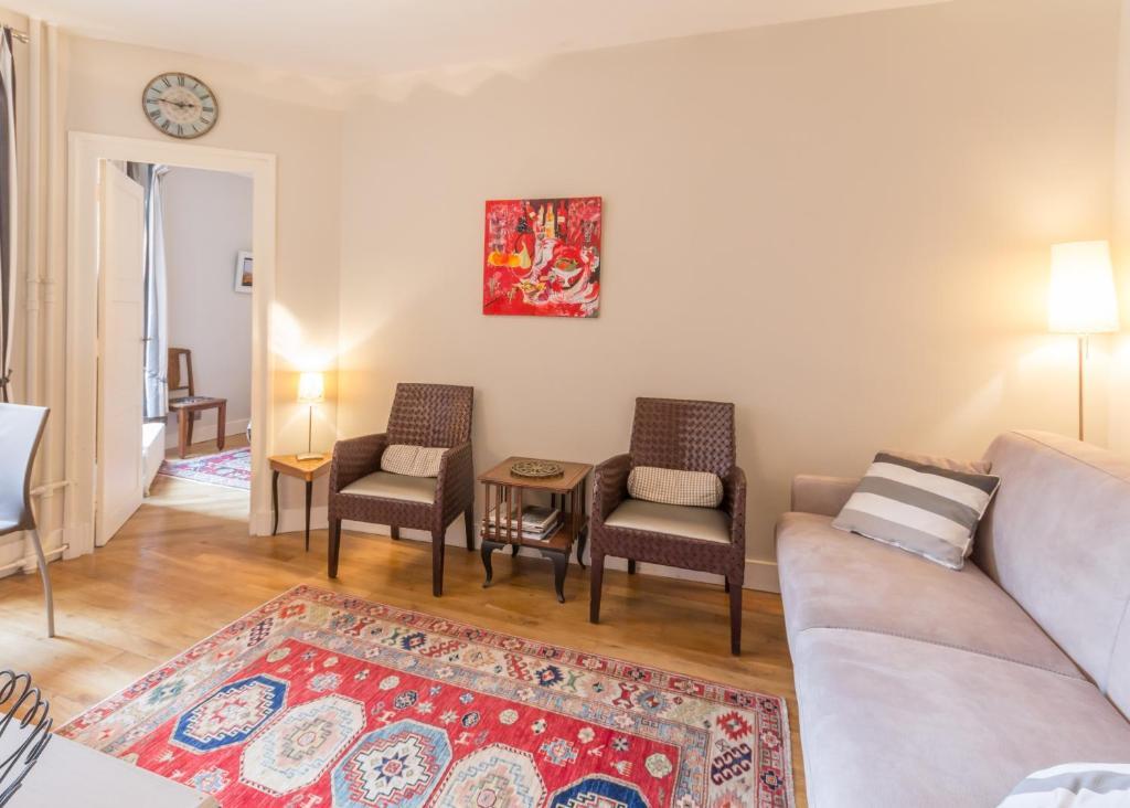 Кът за сядане в Appartement Bijou Paris 5ème