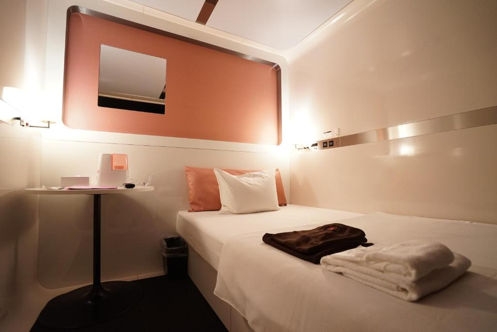 Image result for first cabin capsule hotel