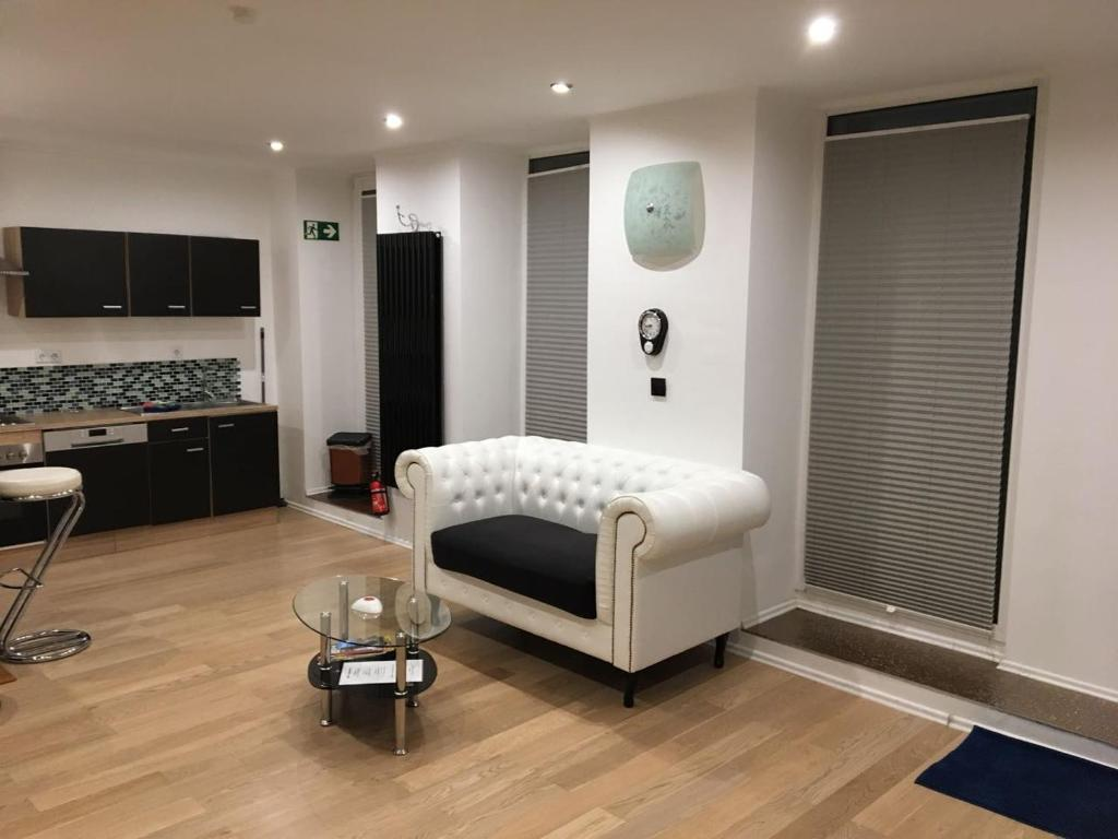 A seating area at modern,light,clean 1Room Apartment central