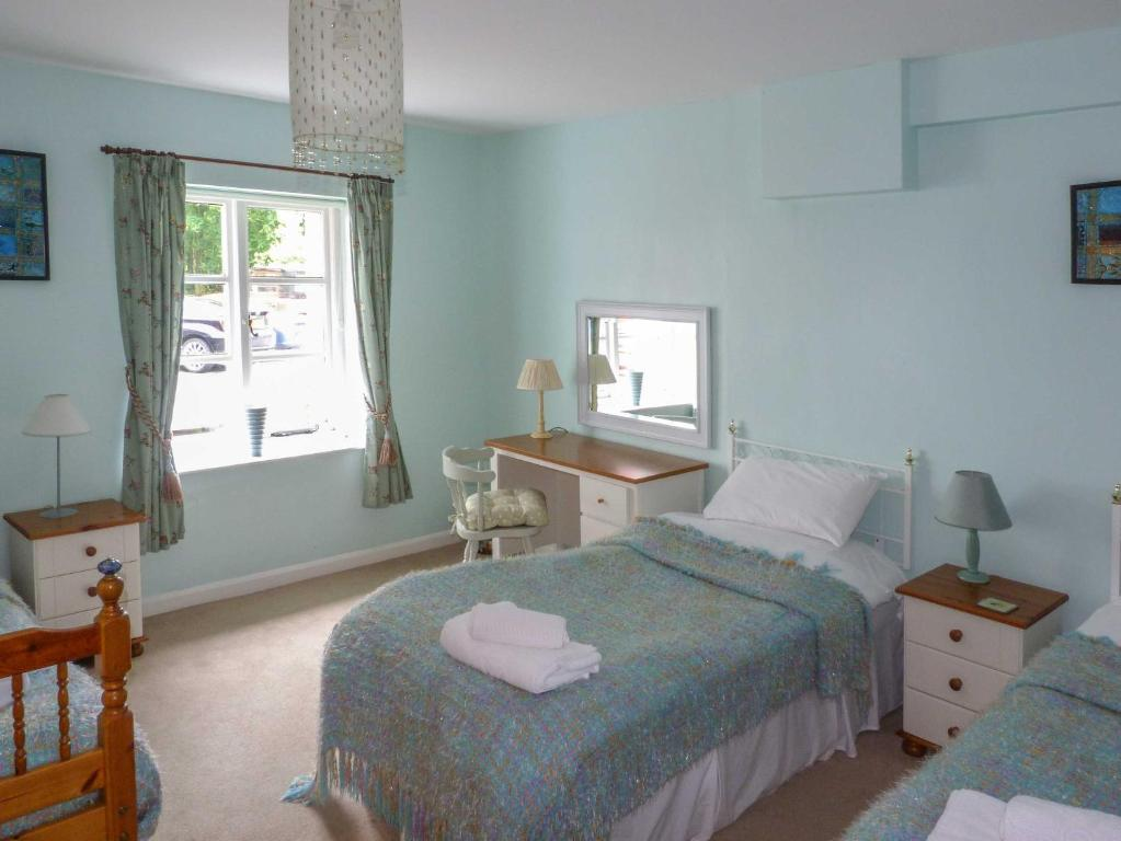 A bed or beds in a room at Uldale
