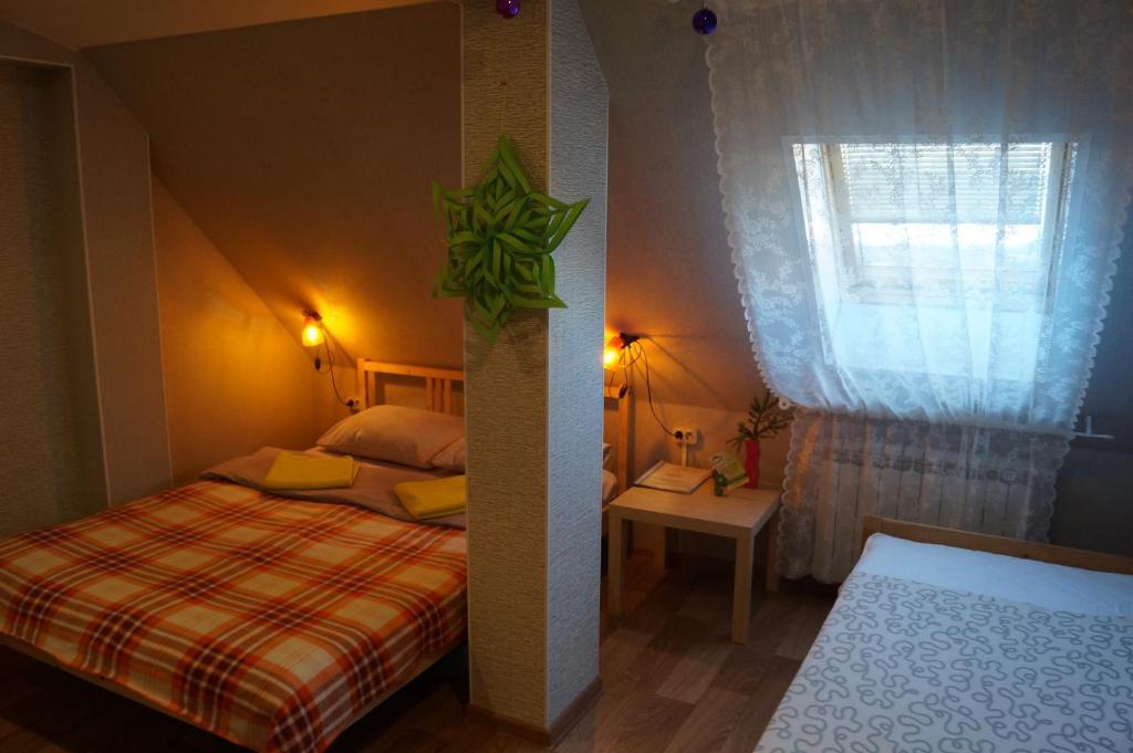 Кровать или кровати в номере Хостел Green Point