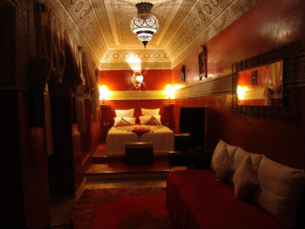 A bed or beds in a room at Riad Les Nuits de Marrakech