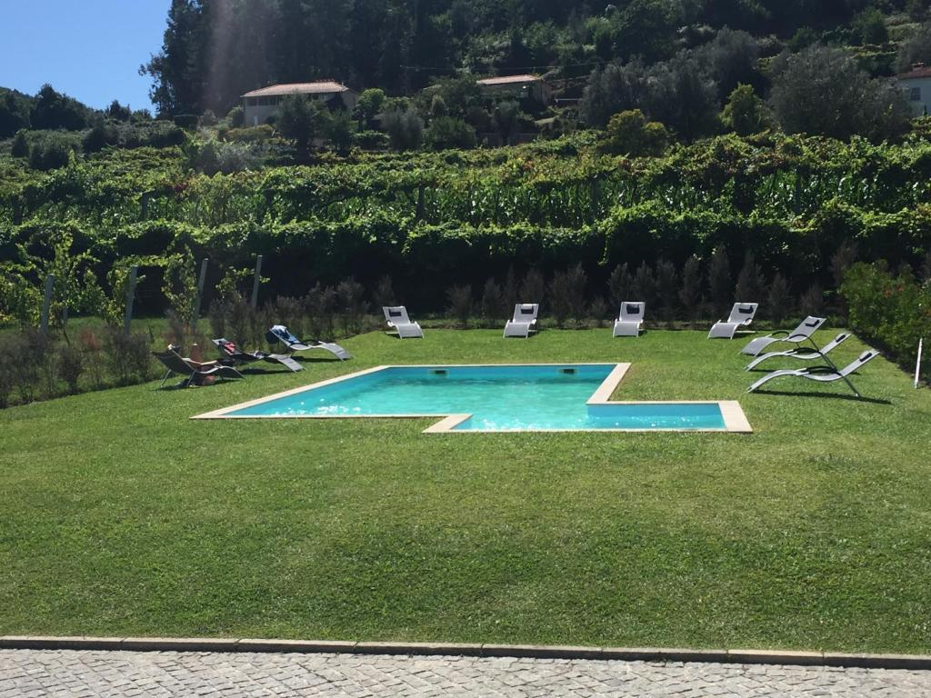 The swimming pool at or near Quinta Dos Brazilaves