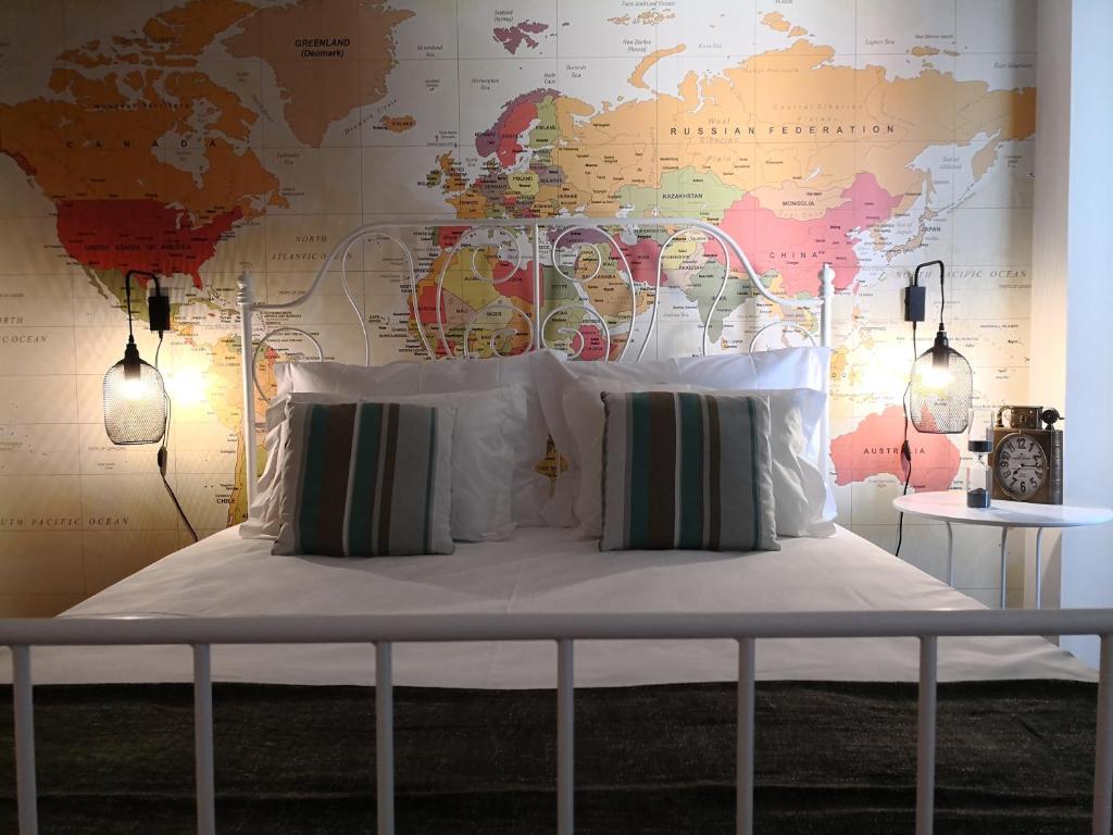 Ліжко або ліжка в номері Travellers Pearl by Storytellers