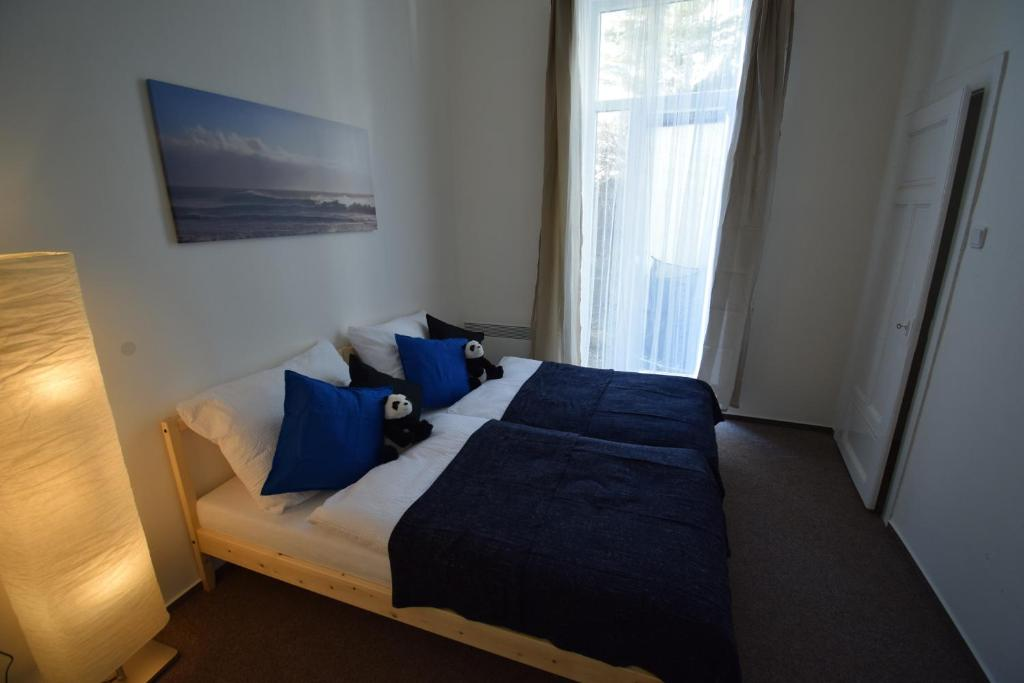 Krevet ili kreveti u jedinici u objektu Ollis garden Apartment