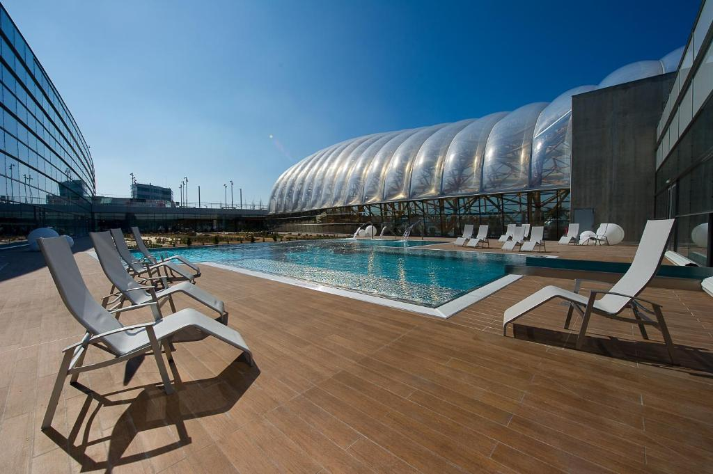 The swimming pool at or near ibis Styles Saint Julien en Genevois Vitam
