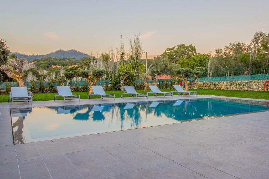 The swimming pool at or near Paço do Bispo Boutique House