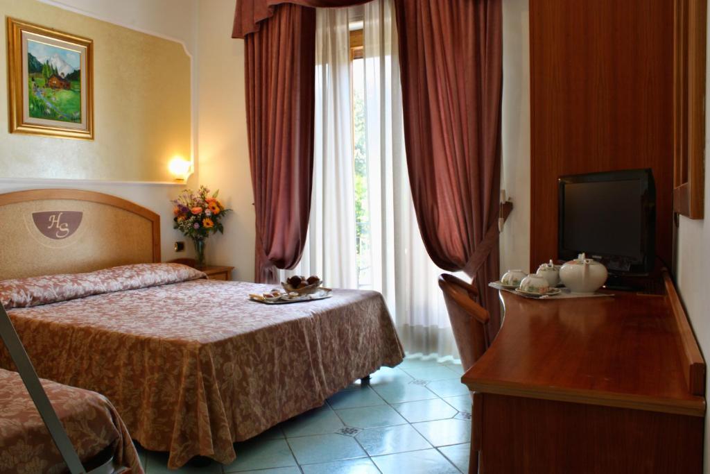 Säng eller sängar i ett rum på Hotel Savoia