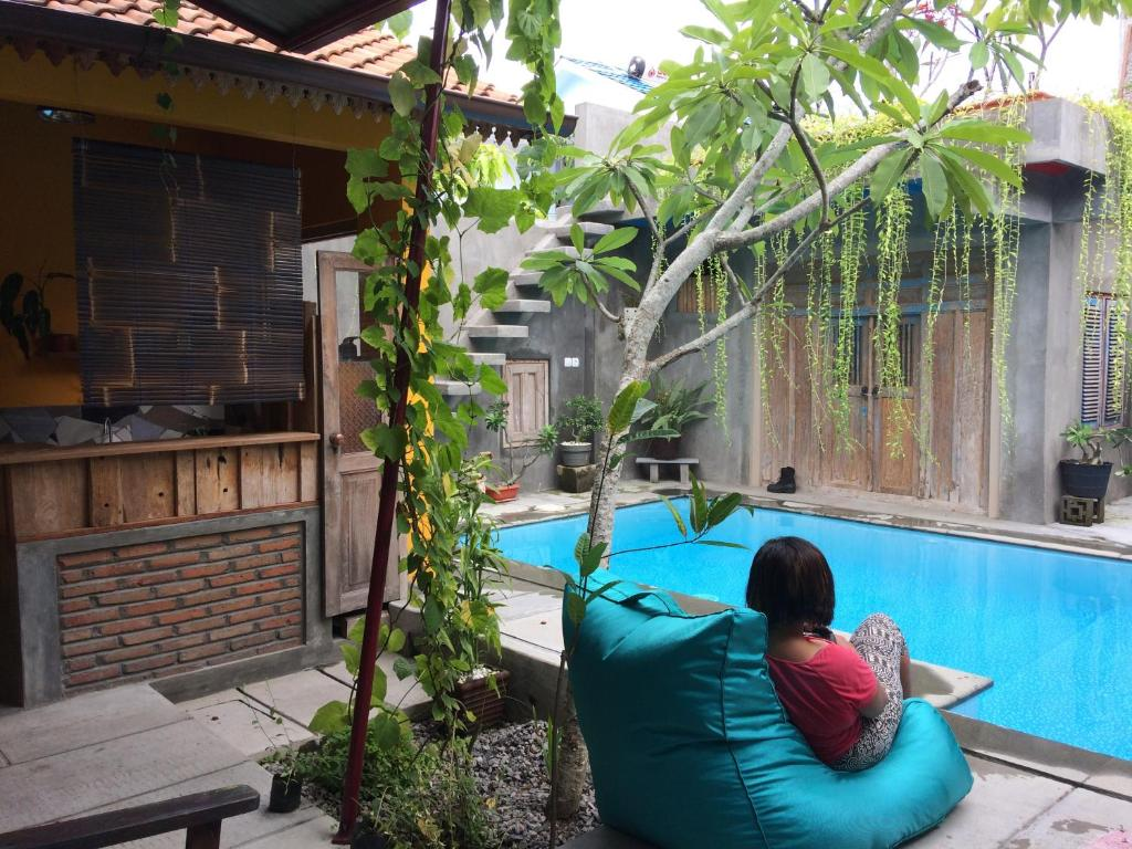 The swimming pool at or near Nextdoor Homestay