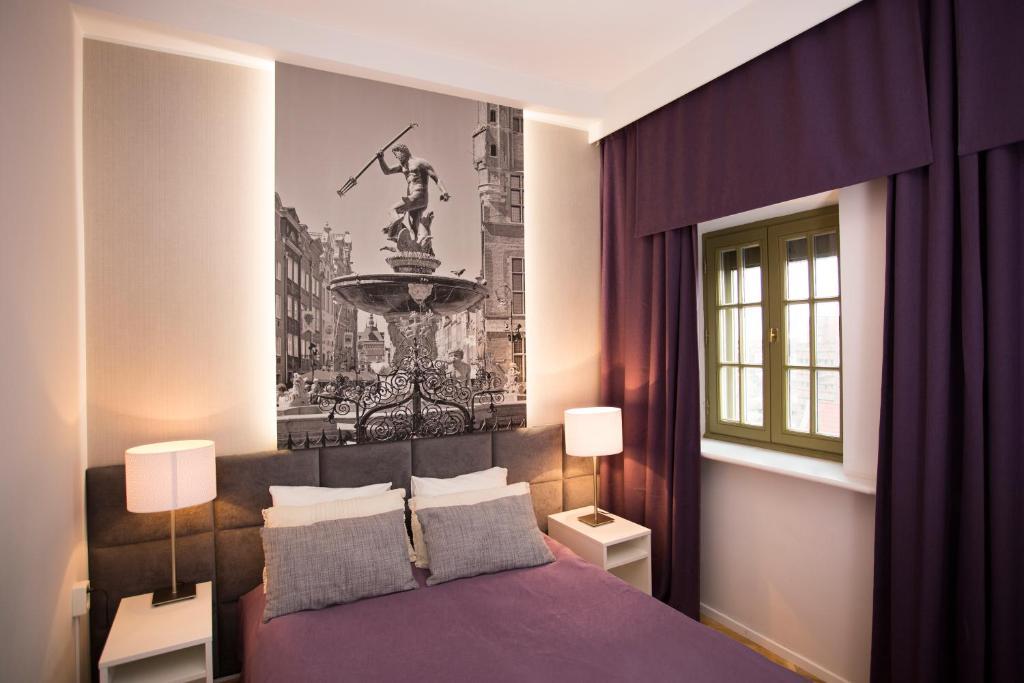 Łóżko lub łóżka w pokoju w obiekcie Pokoje Gościnne ASP
