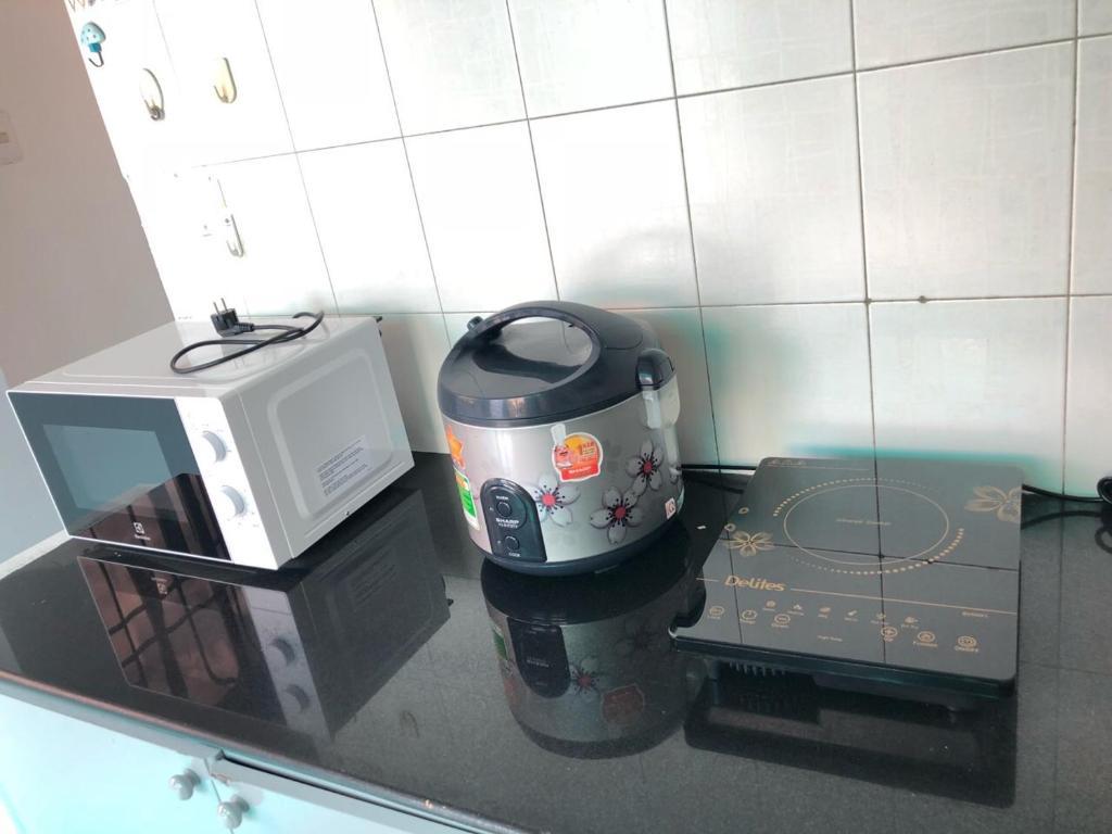 Кухня или мини-кухня в Cozy home near Ben Thanh market