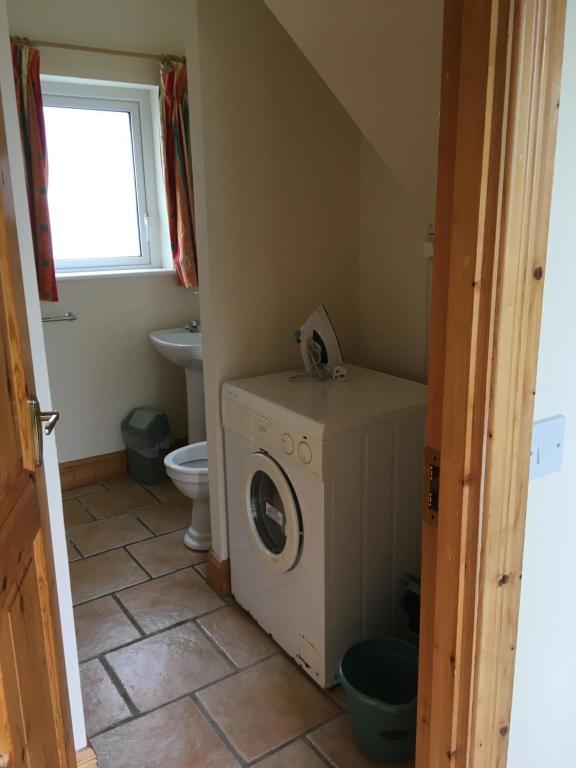 Ett badrum på Beach Cottage