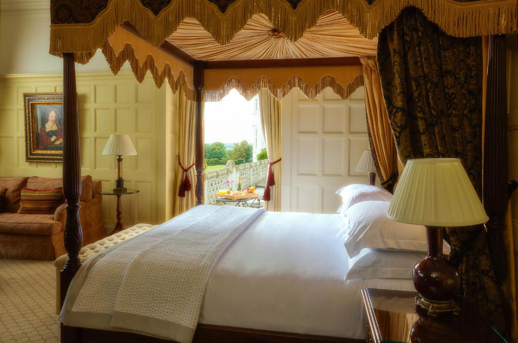 A bed or beds in a room at Danesfield House Hotel And Spa