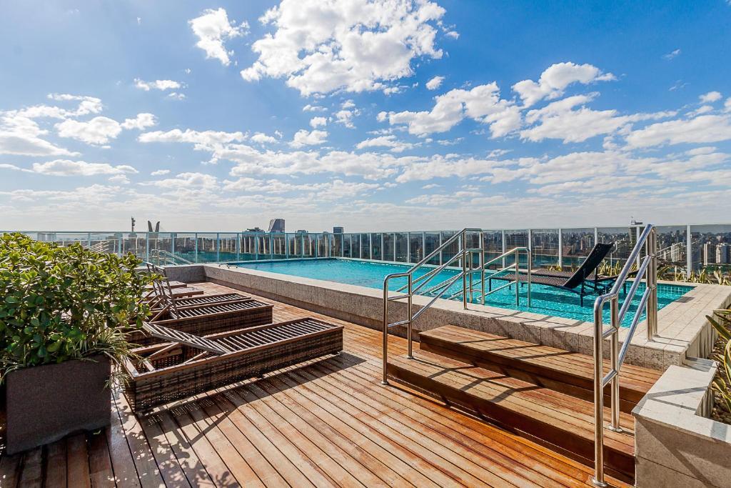 The swimming pool at or near Loft Moderno Berrini