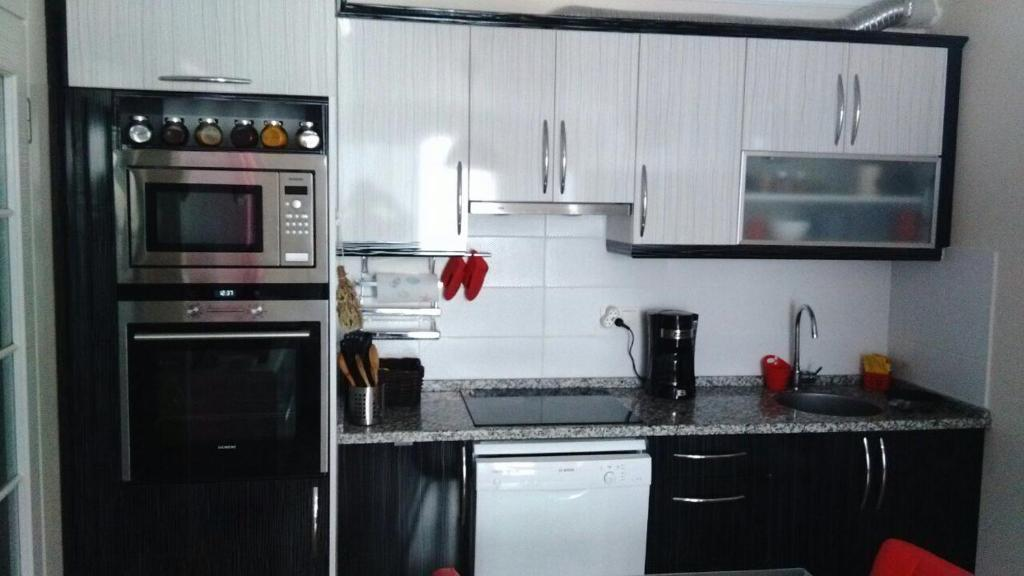 A kitchen or kitchenette at One Bedroom Apartment in Kusadasi City Center
