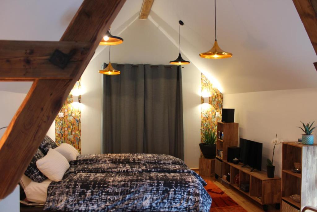 Un ou plusieurs lits dans un hébergement de l'établissement Chez Jane