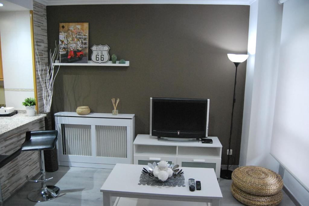 A television and/or entertainment center at Apartamento Laura