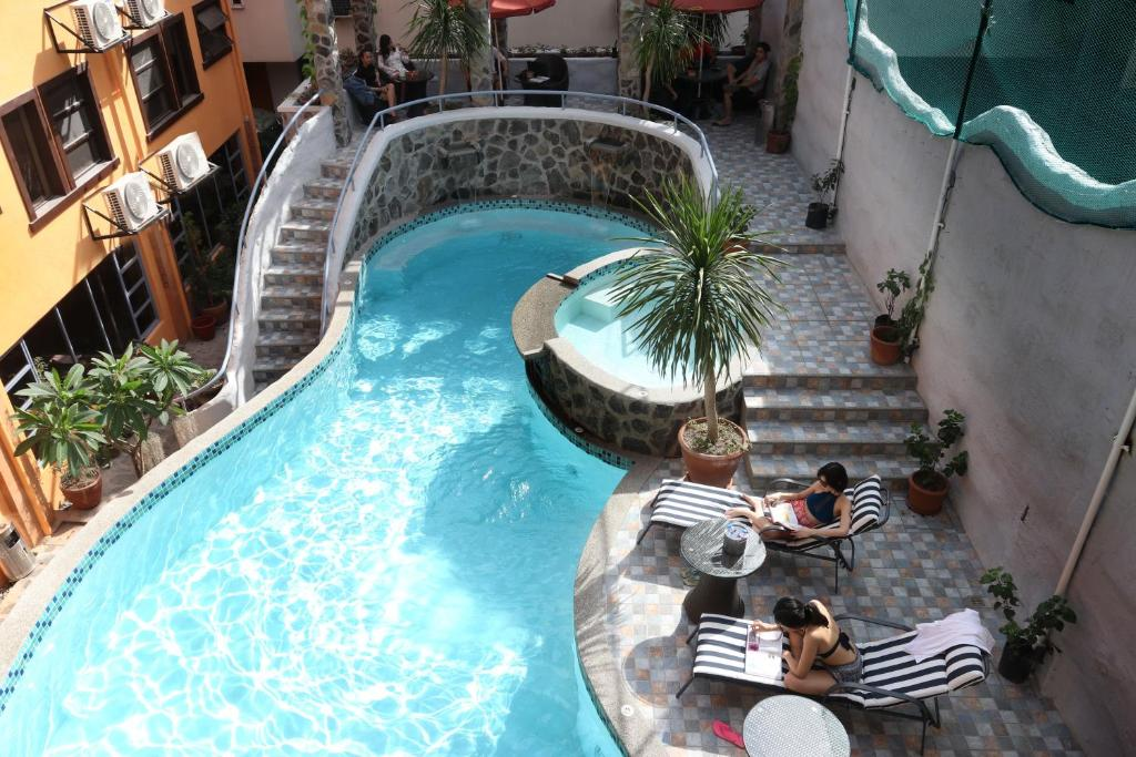 A view of the pool at 1775 Adriatico Suites or nearby