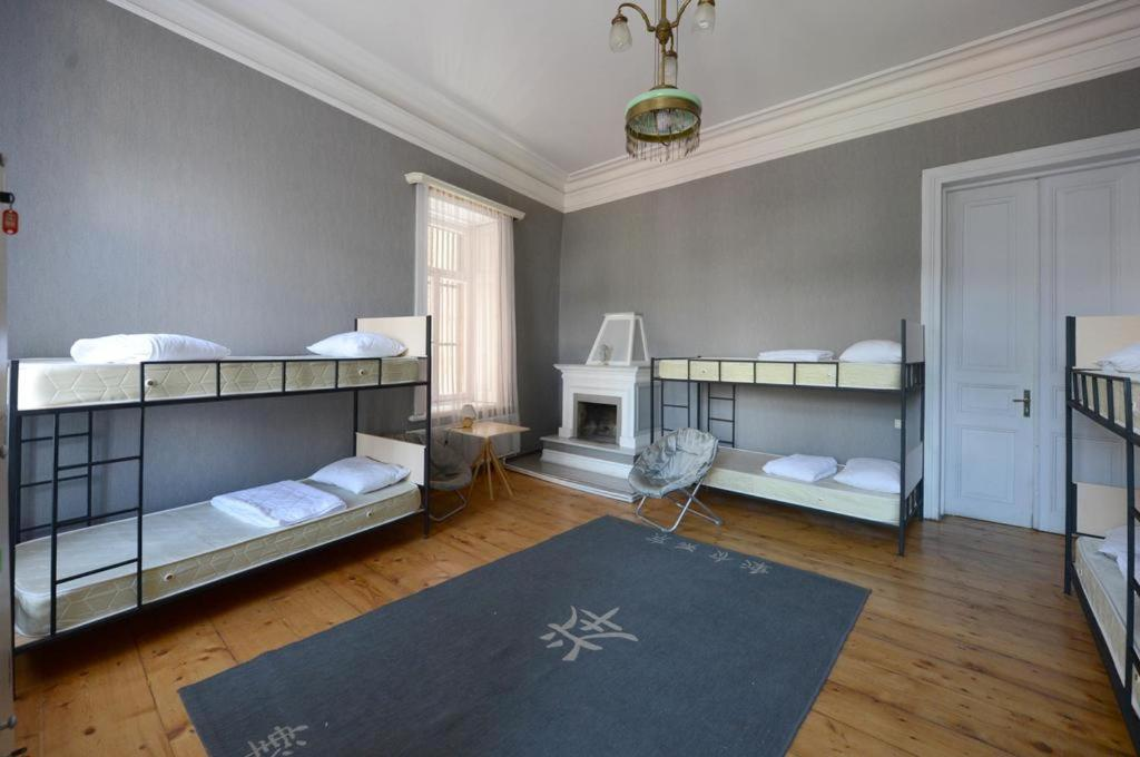 A bunk bed or bunk beds in a room at Lithostel