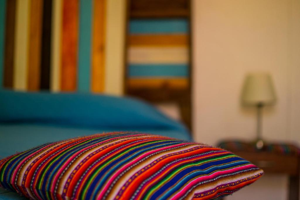 A bed or beds in a room at Casa Lascar