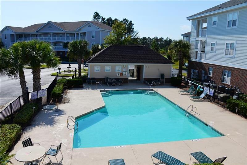 A view of the pool at 822 Cypress Bend Villa or nearby