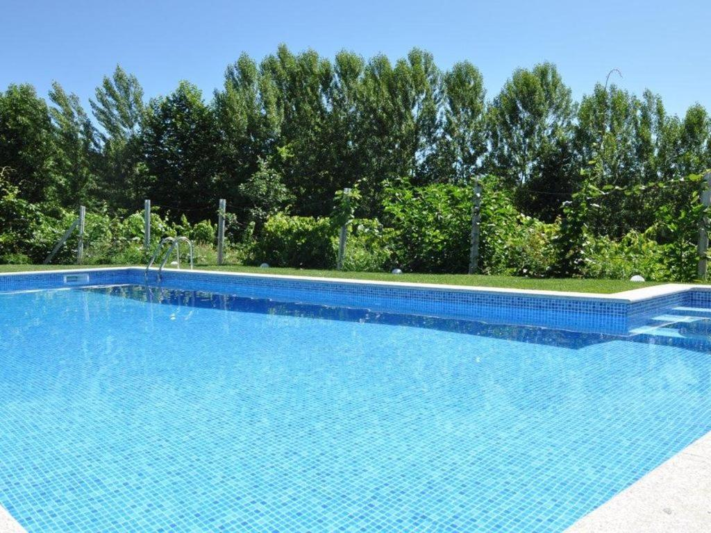 The swimming pool at or near Casas da Costeira