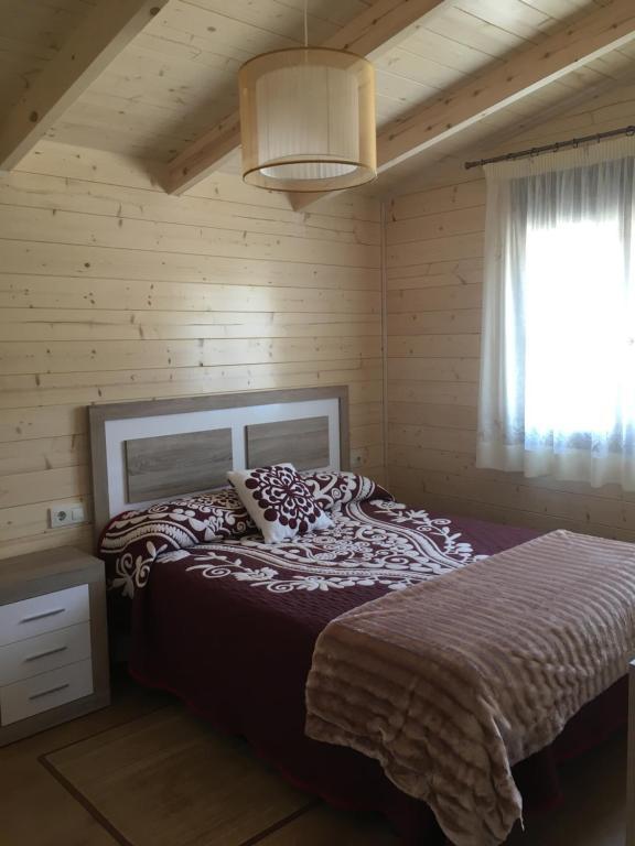 Cama o camas de una habitación en La Escapada