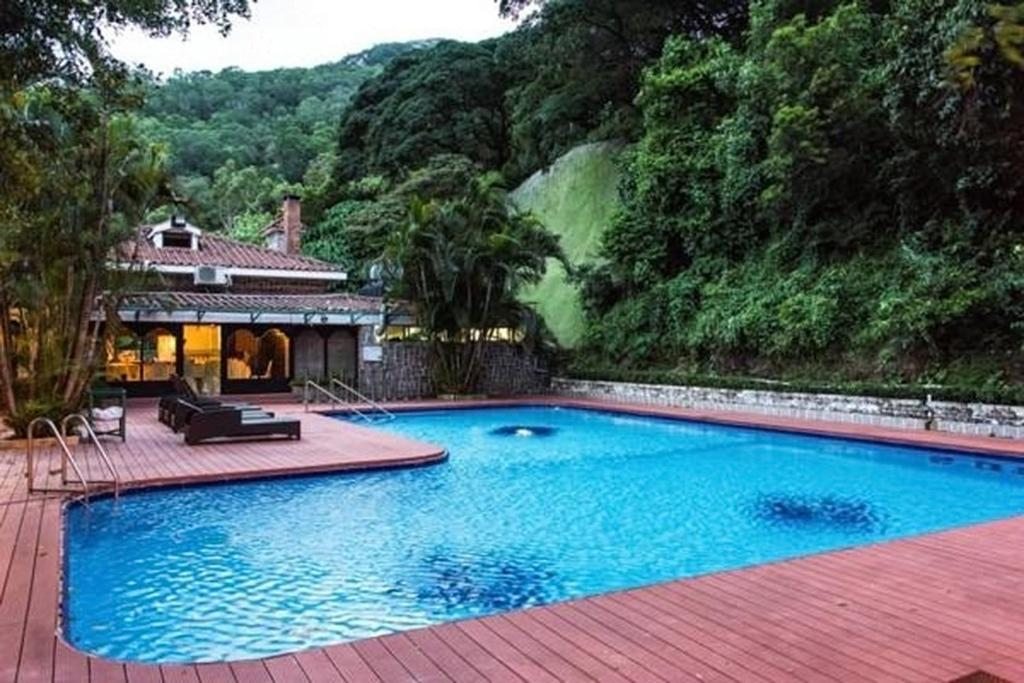 The swimming pool at or near Pousada de Coloane Boutique Hotel
