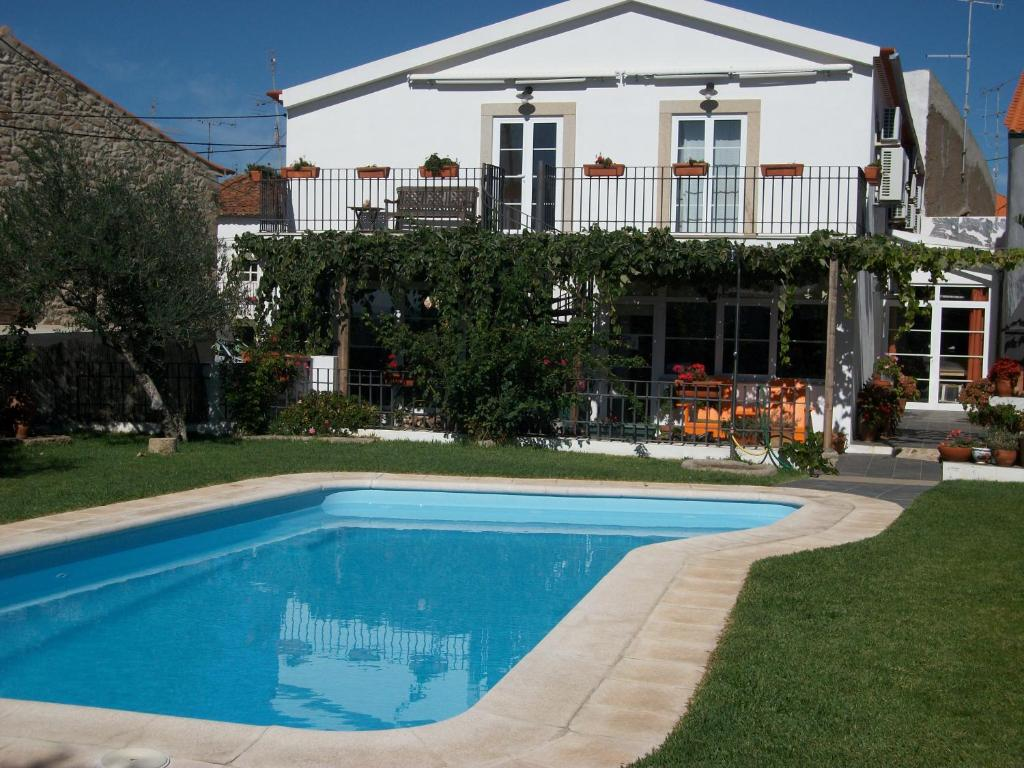 The swimming pool at or near Casa do Forno