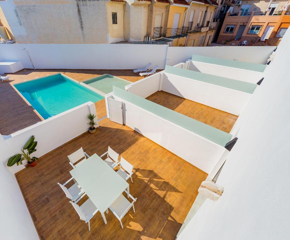 A view of the pool at Apartamentos El Abuelo or nearby